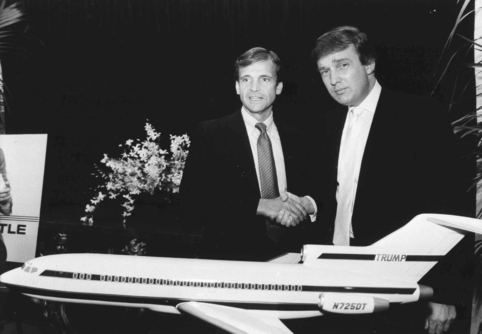 Donald Trump shook hands with Eastern Airlines owner Frank Lorenzo after announcing Trump had agreed to buy Eastern's shuttle fleet.
